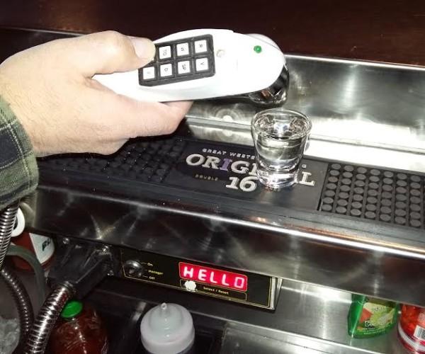A liquor dispenser in action.
